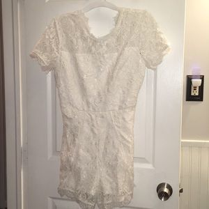 Never worn white Francesca's romper